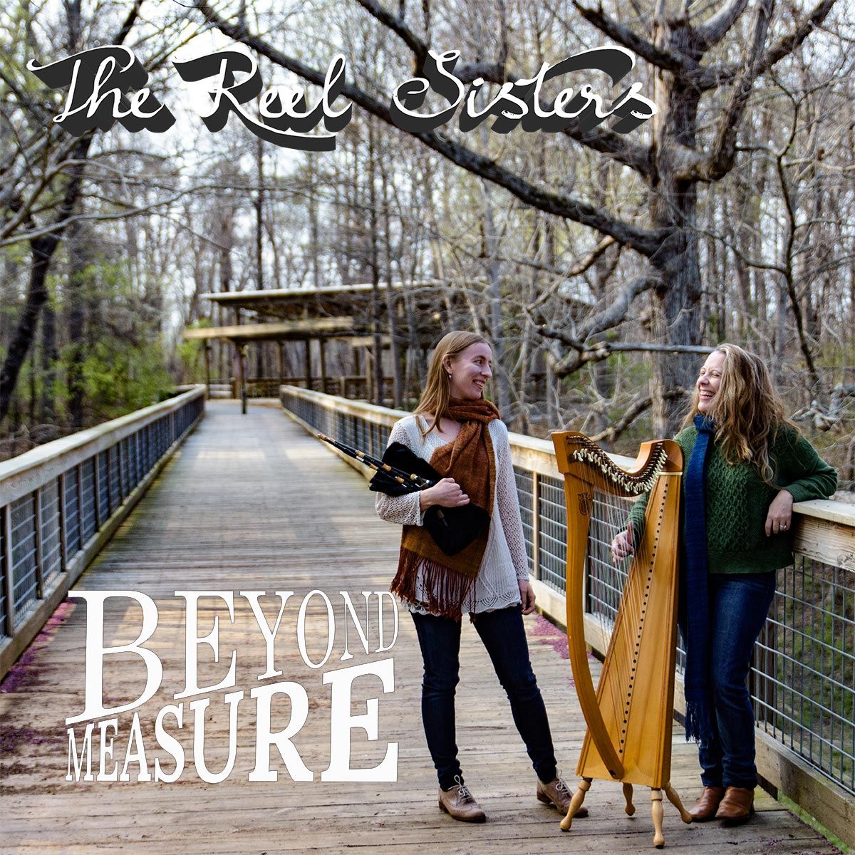 Beyond Measure CD cover. It says The Reel Sisters, Beyond Measure and has an image of Rosalind and Kelly on a bridge with their instruments.